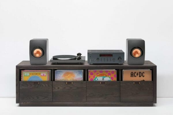 Dovetail Vinyl Storage Cabinet with KEF LS51 Dual Speakers and Pro-Ject Debut Carbon DC Turntable. Features slick blackwood themed cabinets and hold 360 LPs.