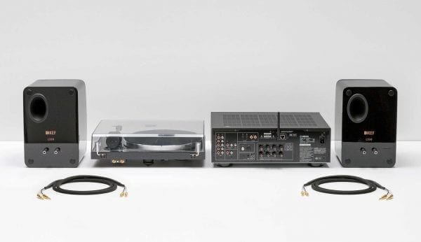 Symbol Audio Preferred Component Package rearview. Includes KEF LS50 Dual Wireless Speakers, Pro-Ject Xpression Carbon Classic Turntable, and Yamaha R-N803 Network Receiver.